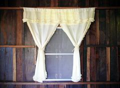 White drape and old wooden window Stock Photos