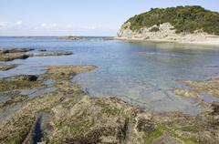 tidal flat rocks - stock photo