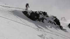 Skier jumping from a cliff Stock Footage