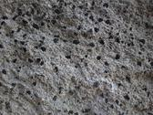 Gritty Speckled Rock Wall Closeup Texture Stock Photos