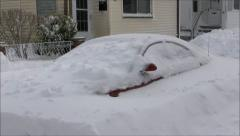 Snow drifts covered car Stock Footage
