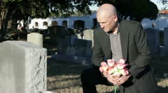 Man at a grave - stock footage