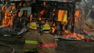 Stock Video Footage of Two firefighters and burning house
