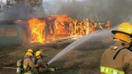 Stock Video Footage of Firefighters and water hose
