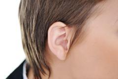 female ear closeup - stock photo