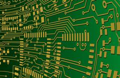 Green and gold circuit board background - stock illustration