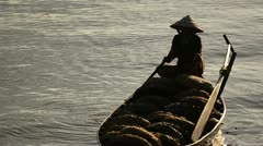 Vietnamese Woman in Conical Hat in Traditional Boat - stock footage