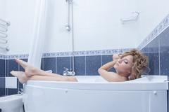 Stock Photo of beauty blonde woman relax in bath
