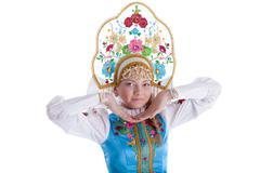 Stock Photo of pretty young girl in kokoshnik isolated