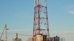 Telecommunication tower with antennas of cellular communication in the sky Stock Footage