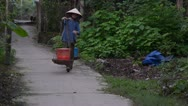 Stock Video Footage of Vietnamese Woman Walking with Traditional Yoke