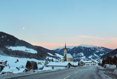 mountain winter kartitsch village and sunrise (austria). - stock photo