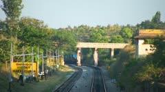 Speeding evening passenger train near Bangalore India. Stock Footage