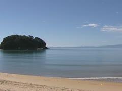 View of Abel Tasman bay from Kaiteriteri beach + pan Stock Footage