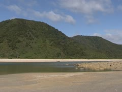 Low tide in Awaroa bay in Abel Tasman National Park - pan Stock Footage