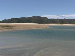 Low tide in Awaroa bay in Abel Tasman National Park Stock Footage