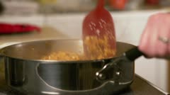 Chicken cooking in skillet Stock Footage