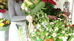 Florist Arranging Bunch Of Flowers In Floristry Shop - stock footage