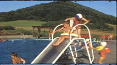 Vintage 8 mm film: Children in swimming pool, 1970s Stock Footage