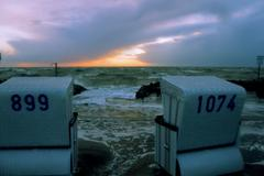 beach chairs for storm, north sea, buesum - stock photo