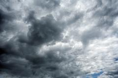 Heavy  black stormy clouds Stock Photos