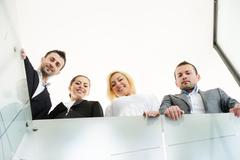 Successful business people on railing Stock Photos