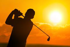 Stock Photo of golf sunset silhouette