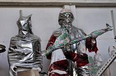 statues wrapped in plastic - stock photo