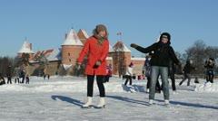 Active winter sport skate ice frozen lake castle fort trakai Stock Footage