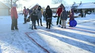 People play winter game curling eisstock frozen ice Trakai Stock Footage