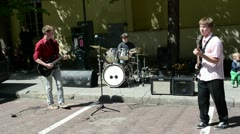 students play guitar drums in street. hard rock - stock footage