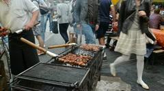 Baking meat fire ember outdoor street restaurant Stock Footage