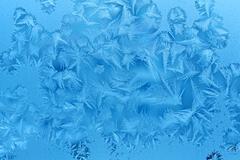 ice patterns on winter glass - stock illustration