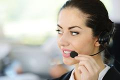beautiful support girl in calling centre - stock photo