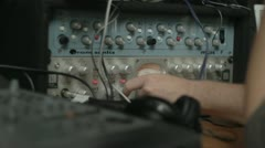 Turning knobs on Avalon preamp Stock Footage