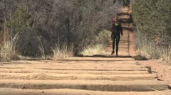 130205v woman walking down the manitou incline low angle from right Stock Footage