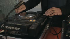 DJ on cd player and mixer Stock Footage