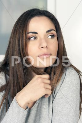 Stock photo of portrait of beautiful pensive young woman
