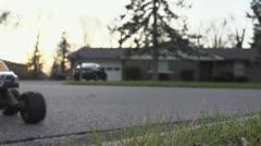 Remote Control car jumping street curb Stock Footage