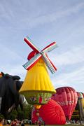 barneveld, the netherlands - 17 august 2012: colorful windmill and red air ba - stock photo
