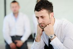 business people with stress and worries in office - stock photo