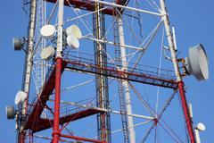 Telecommunication tower with antennas of cellular communication in the sky Stock Photos