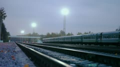 Abandoned train and light tower against blue sky at evening Stock Footage