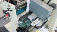 Sticker machine makes labels for sugar, closeup view from above Stock Footage