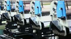 Row of machines in printing conveyor, shown in motion Stock Footage