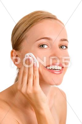 Stock photo of attractive girl applying face pack