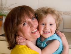 Beautiful and happiness grandmother with granddaughter Stock Photos