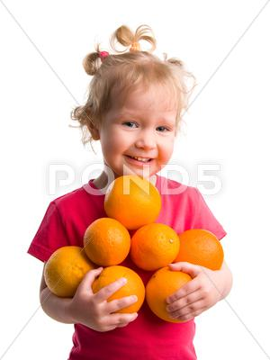 Stock photo of beautiful girl with oranges