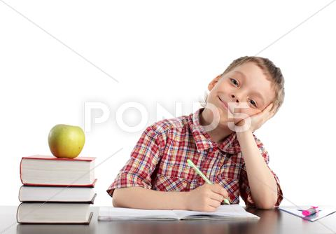 Stock photo of boy does lessons