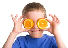boy with an orange - stock photo
